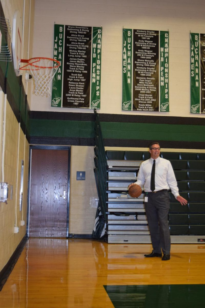 Dr.+Strine+isn%27t+all+work+and+no+play%21++He+took+a+moment+to+show+off+his+basketball+skills+for+the+JB+Student+Media+staff.