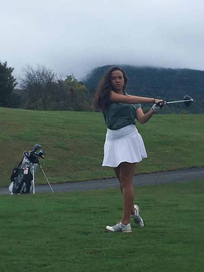 Taking+a+nice+swing+Claire+sends+the+ball+towards+the+hole.+Photo+Credit%3A+Maricris+Alfree