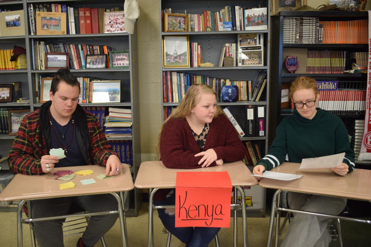 In Mr. Lum's Economics class, Dakota Blair (12), Sierra Suffecool (12), and Sarah Hoffeditz (12) are working together to plan their next purchase.