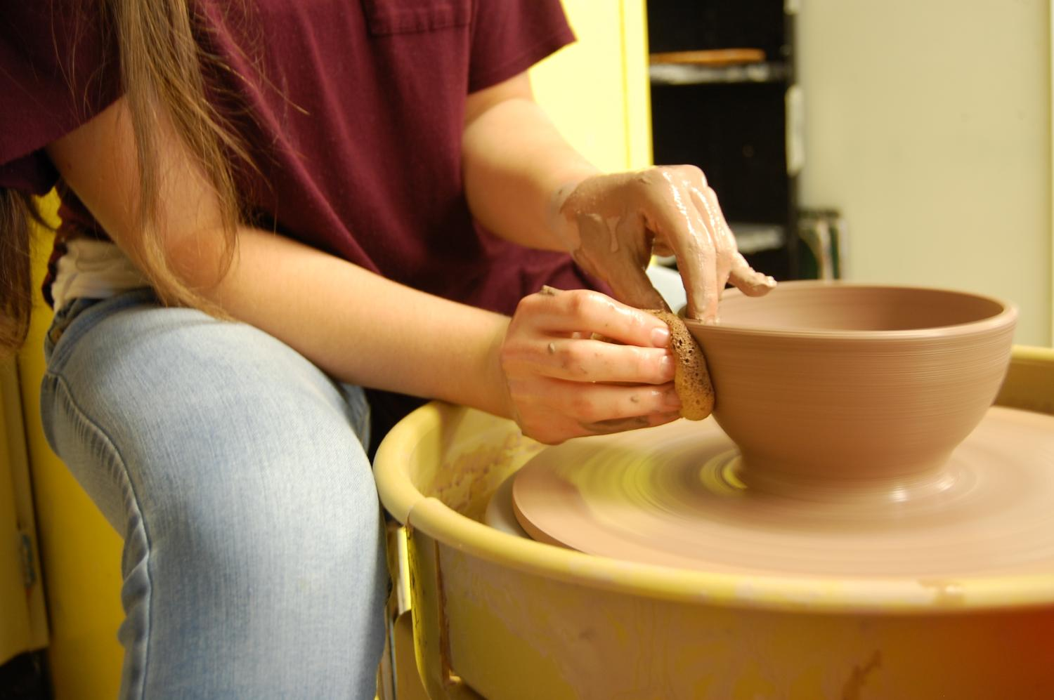 Caroline Zimmerman, 9, starts shaping her bowl on the wheel. Photo by Madison Dorsey.