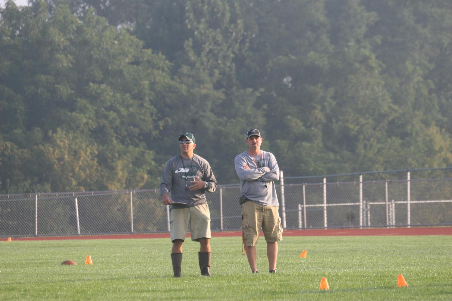 Pictured above, Coach Stoner (left) and Coach Ellis (right) stand and observe a Saturday morning practice of flag football.