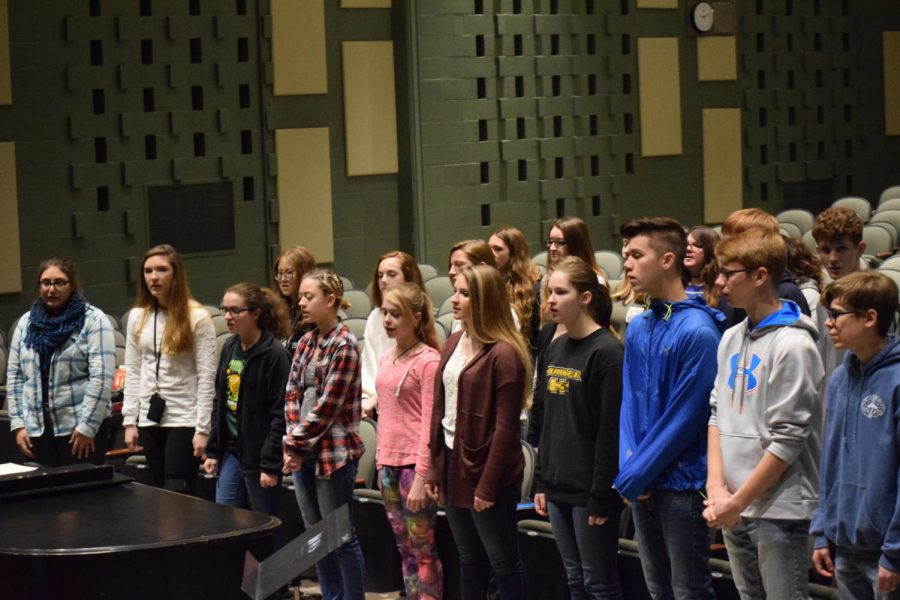 The+James+Buchanan+High+School+Chorus+warming+up+for+rehearsal.+