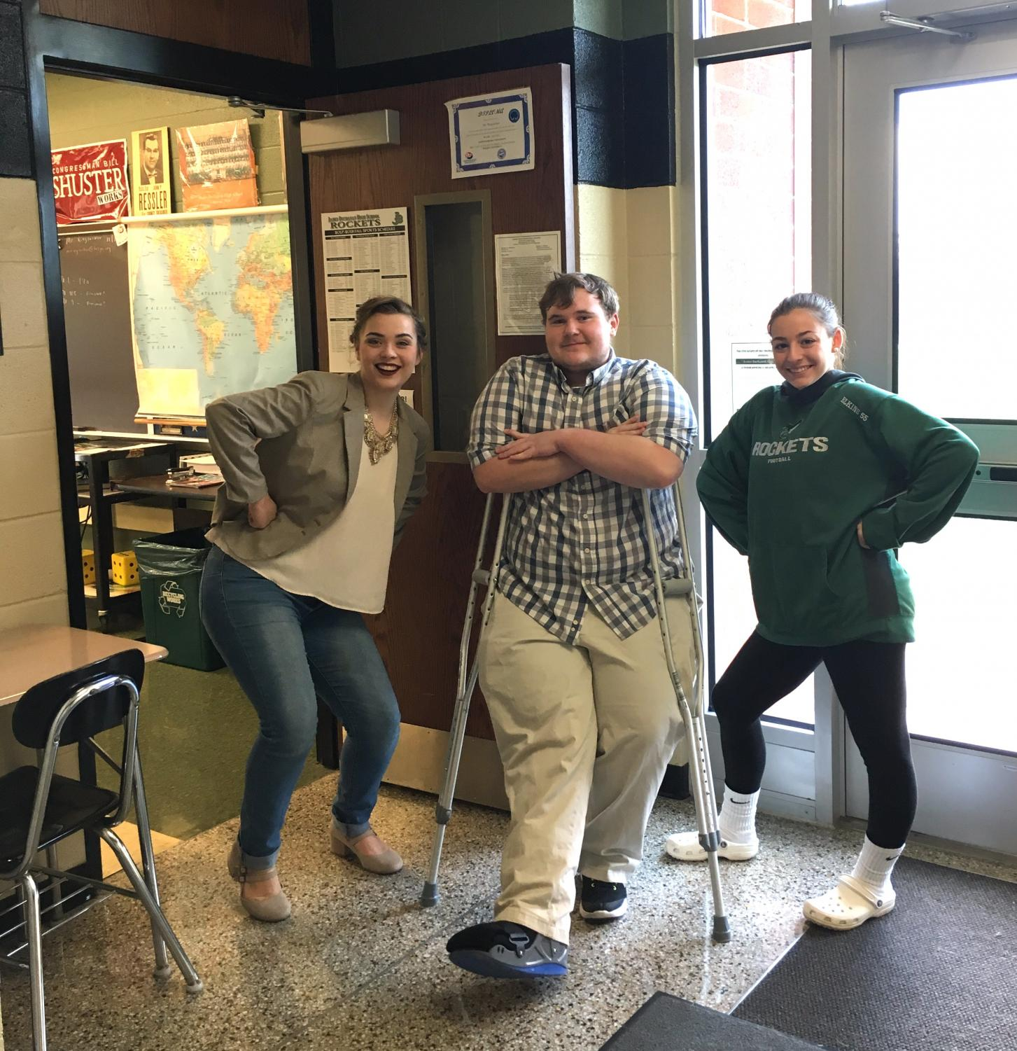 Standing at the door of 3:15 Student Ministries, Jacquelyn Wagaman (11), Dawson Thomas (11), and Harley Rife (11) welcome attendees and guests.