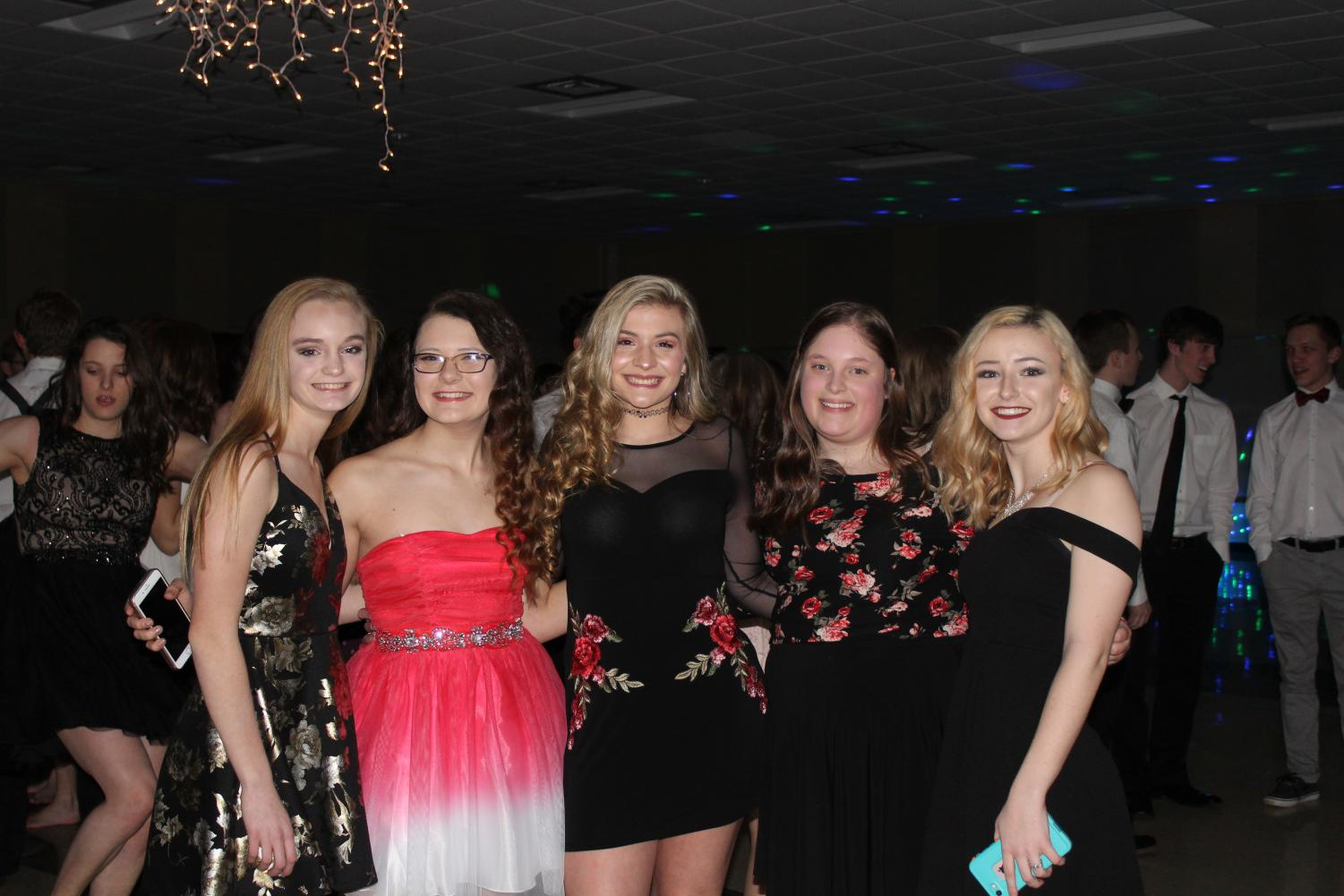 At the Sadie Hawkins dance, Tia Campbell (10), Victoria Hutchison (11), Mercedes Shank (11), Kristin Embly (11), and Jade Hornbaker (11) enjoy their time together.