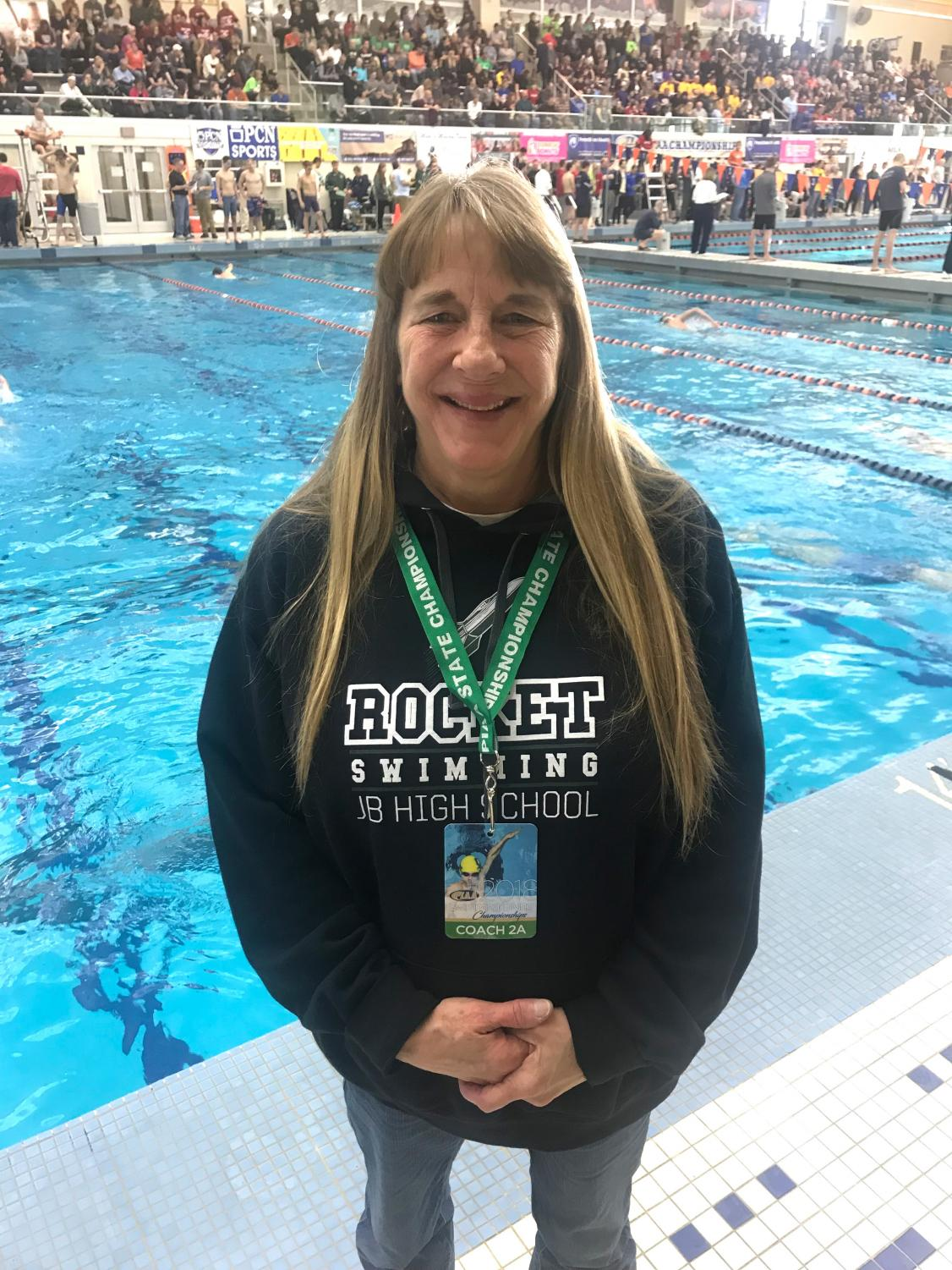 At a championship swim meet, Shellie Viertz is in charge of coaching several swimmers.