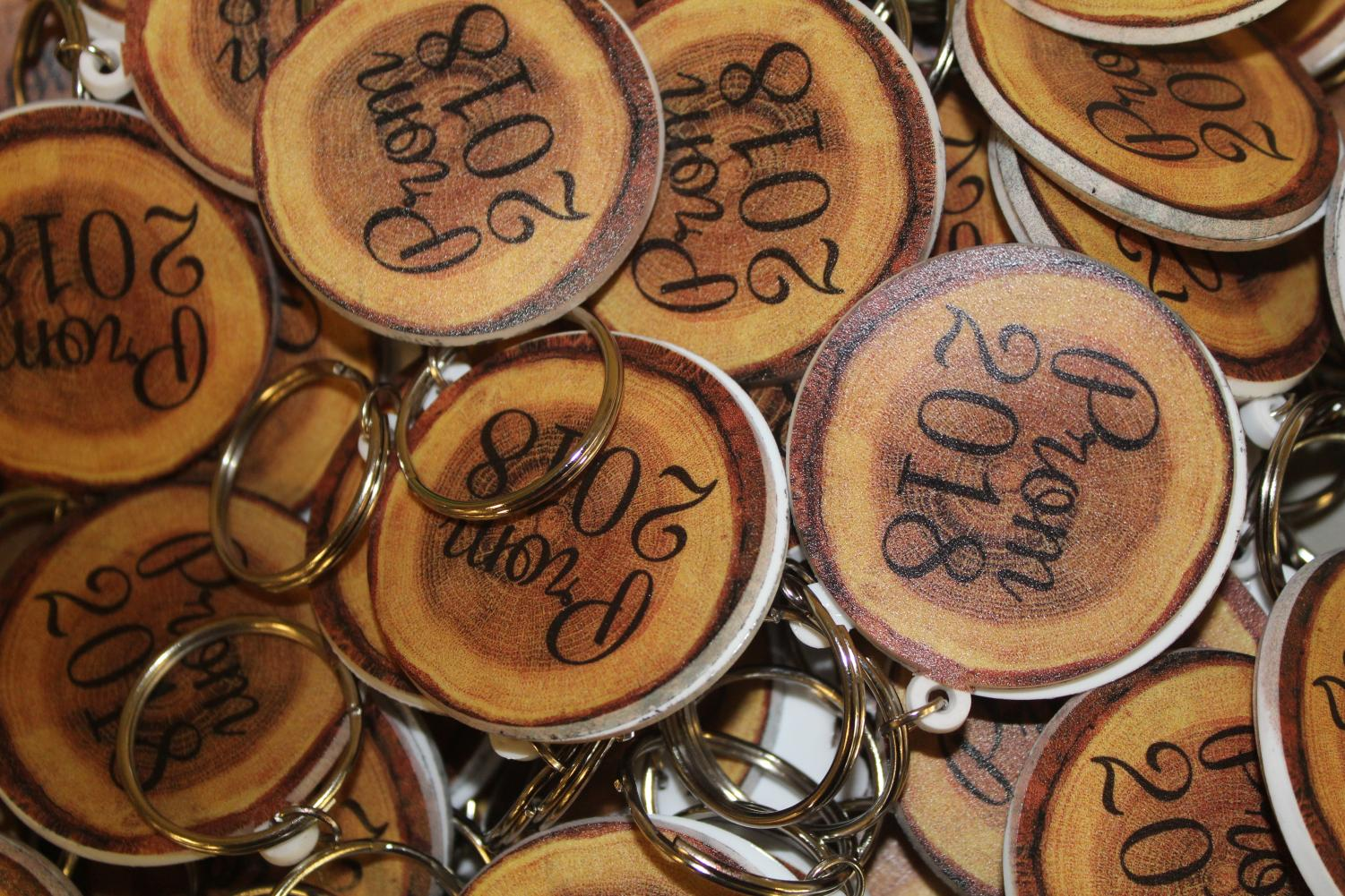 This year's Prom tickets are rubber keychains that look like wood to represent the