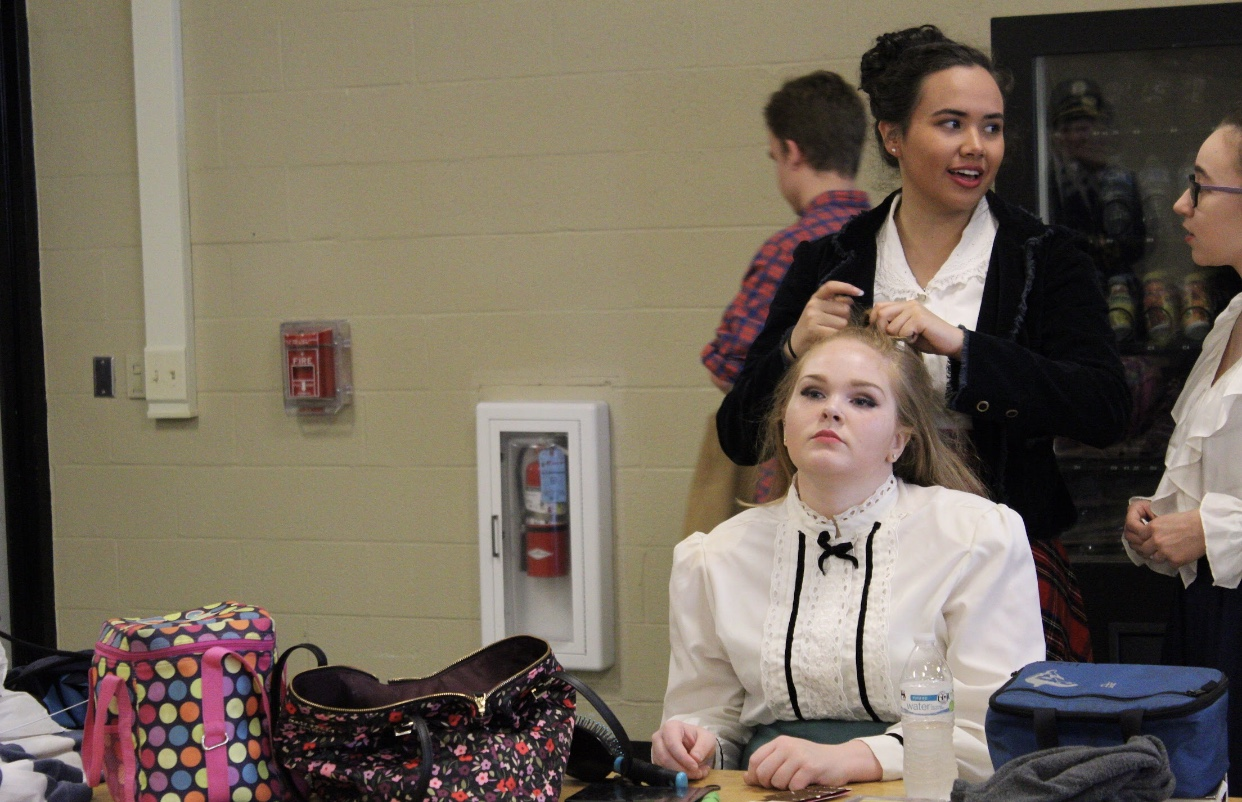 While getting her hair done by Claire Alfree (12), Kelsi Parson (11) ponders about Sunday's performance.