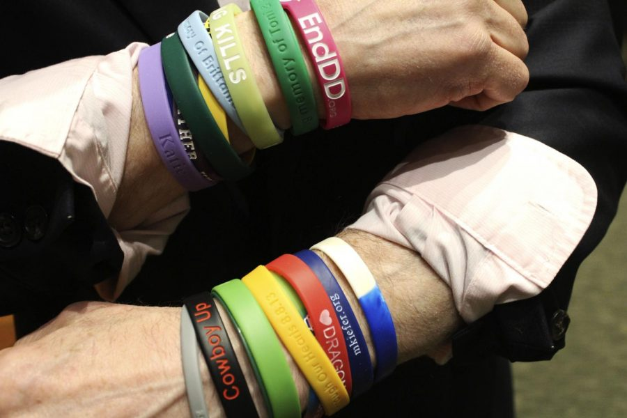 Joel+Feldman+wears+bracelets+honoring+many+boys+and+girls+who+lost+their+lives+to+distracted+driving.+Each+bracelet+has+its+own+story+that+Mr.+Feldman+sees+when+he+looks+at+his+wrists.