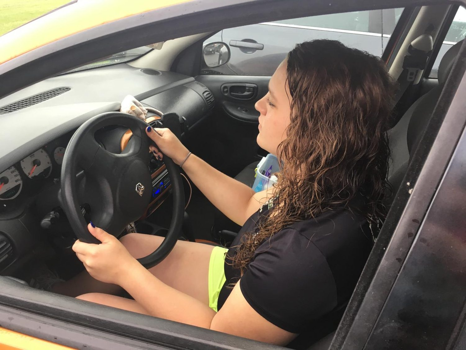 Parking in the school parking lot, Sammie Mills (12) shows off skills learned through taking Driver's Education and Driver's Simulation