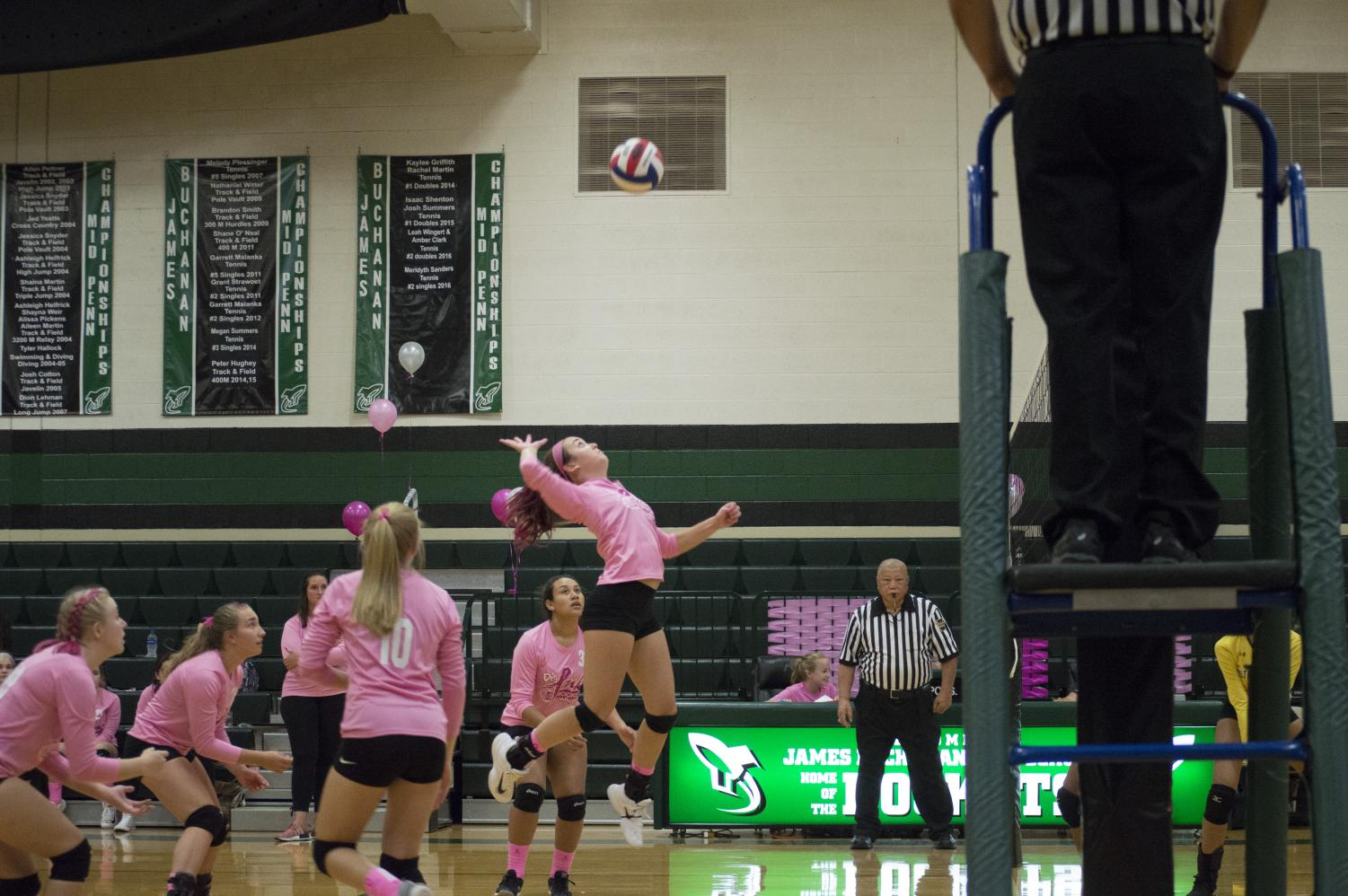 Rylynn Welsh (9), a freshman starter, attempts to make a kill on the opposing team's side to bring back JB in points.