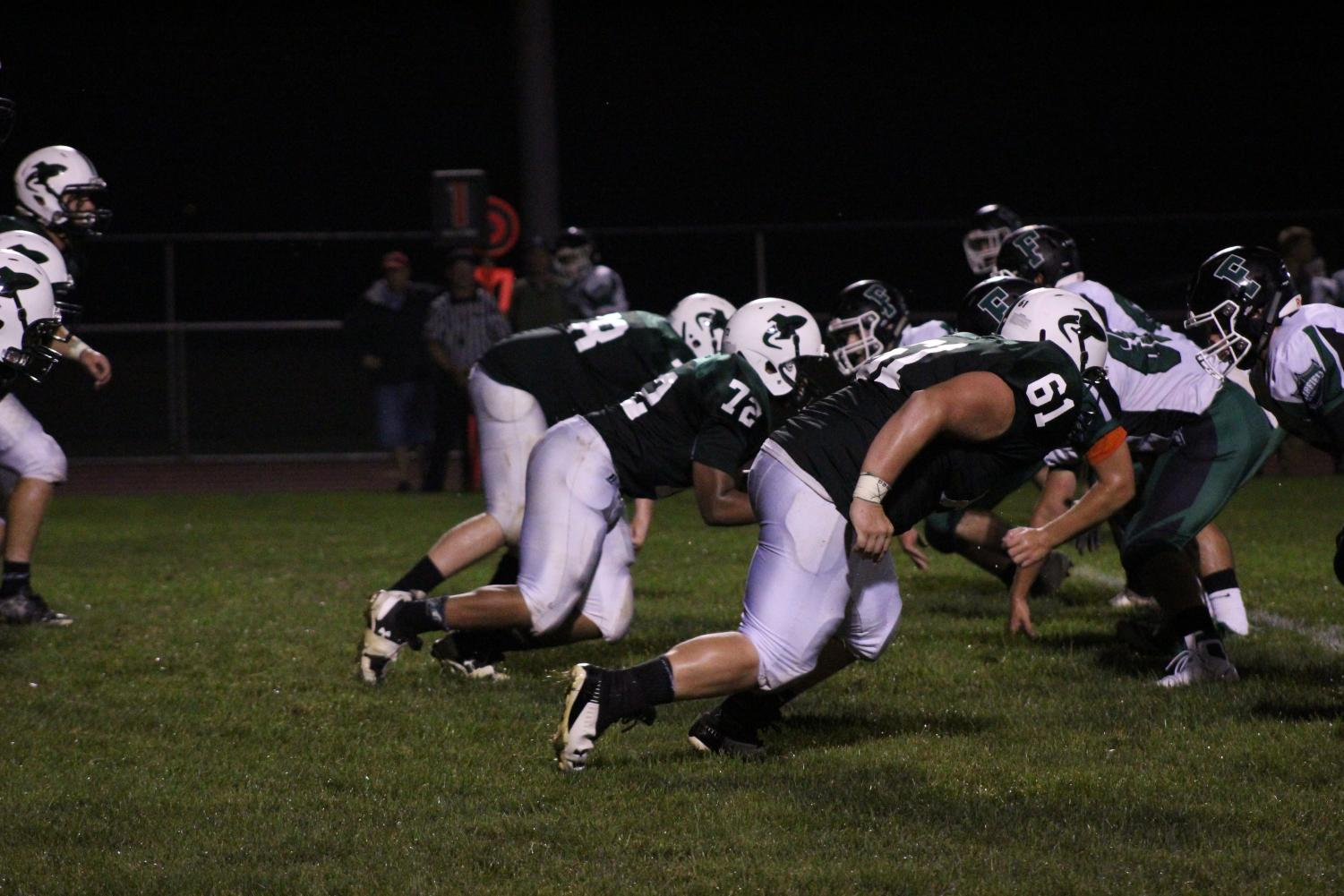 Logan Spoonhour (12) plays the defensive line for the Rocket football team.