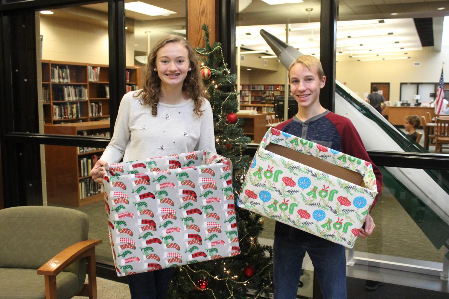 Encouraging fellow classmates, Claire Kriner (11) and Timothy Helman (9) get excited for the holiday season.