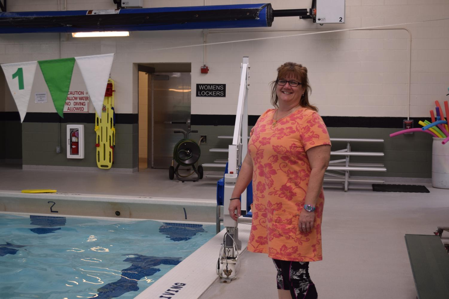 Ms. Angi Johnson (Faculty) smiles on the pool deck at James Buchanan High School.