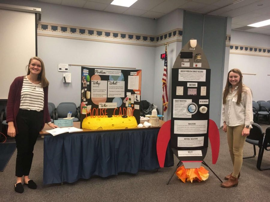 Maggie+Strawoet+%2812%29+and+Jade+Wolfe+%2811%29+stand+by+their+table+presenting+their+invention+at+one+of+the+competitions.+