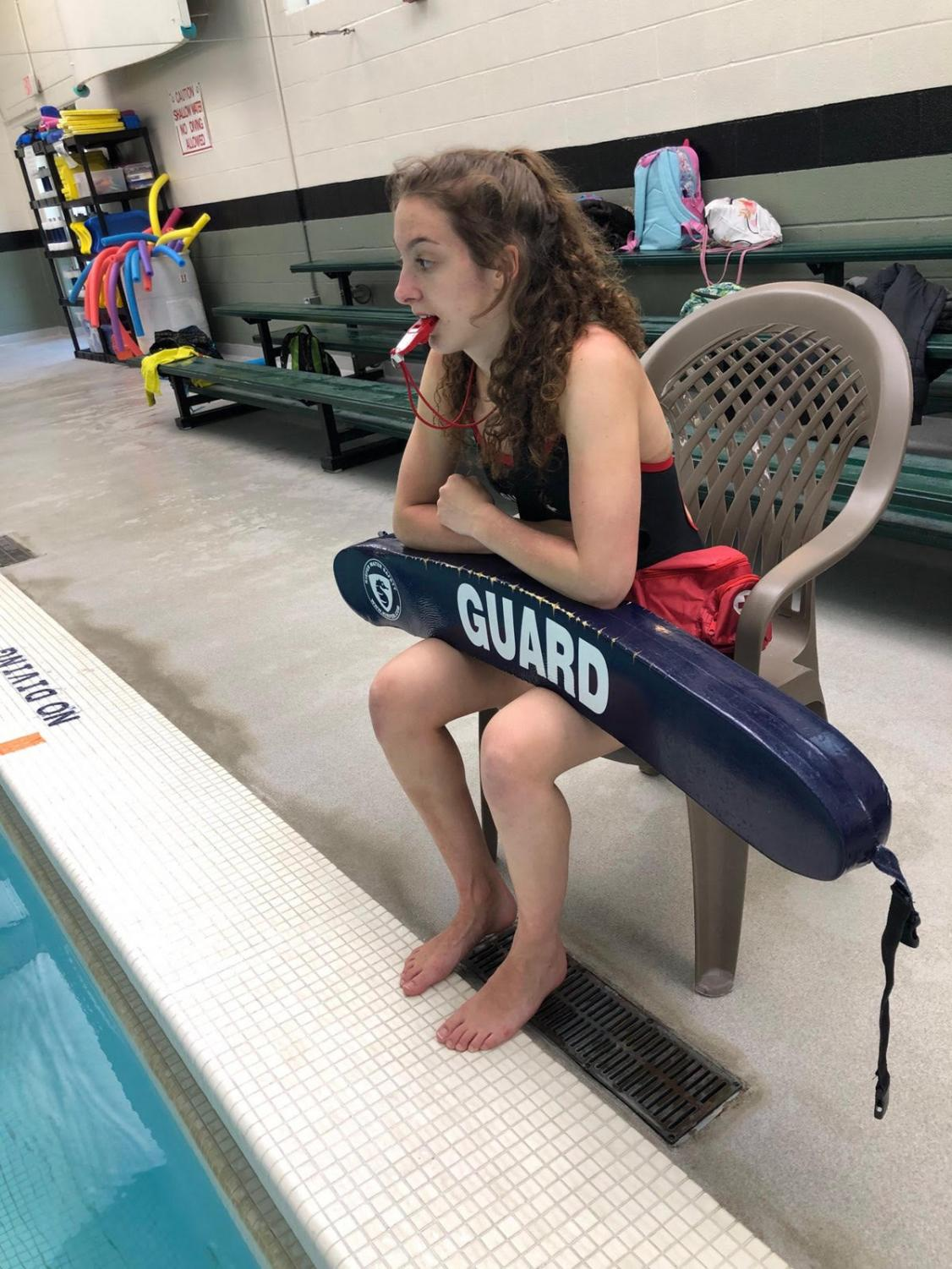 Sarah Kimmel (11) monitors  the pool, while on her lifeguarding duty.
