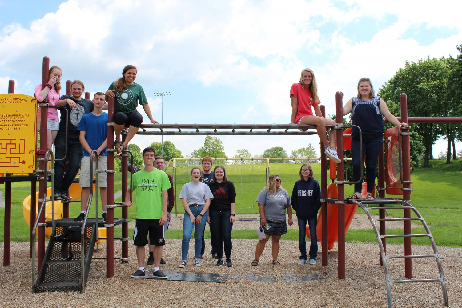The ap chemistry class poses for a picture on the playground at St. Thomas Elementary. Carlee Jackson (11), Tanner Myers (11), Jordan Harbold (11), Alyssa Blair (12), Daniel Corcoran (12), Trenton Morgan (12), Amanda Sensinger (11), Dale MIller (12), Mackenzie Saunders (11), Alyssa Velasquez-Glant (12), Kayla Noll-Bader (12), Ella Jones (12), and Abby Carbaugh (12)