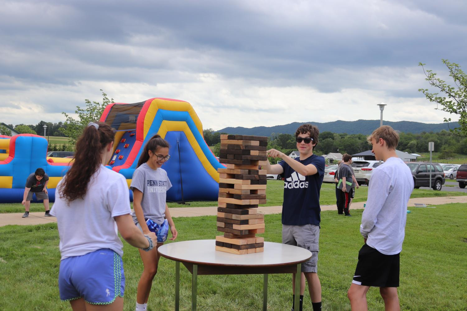 Playing some jenga, Sadie Garbinski (9), Ashley Alfree (9), Colby Starr (10), and Kaanan Hissong (10) work to not knock down the stack.